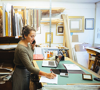 A woman working at a framing shop