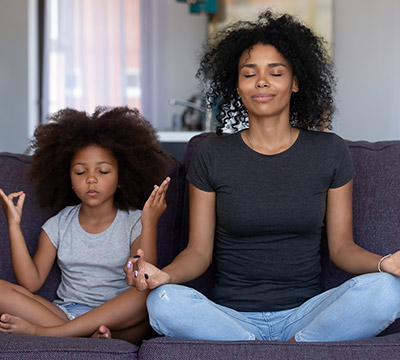 Mother and child meditating