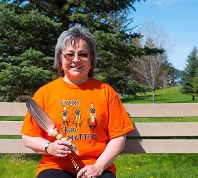 Phyllis Webstad wearing an orange shirt